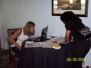Kathy Macaluso and Barbara Osceola talking with Nancy Kanelopoulos on the computer